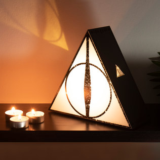 Picture of: Deathly Hallows Projection Light | Secret Santa Generator Gifts